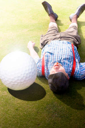 titled: Injured Golfer Gets Hit And Knocked On To His Back By An Enormous Golf Ball In A Sport Injury Of Hilarious Proportions Titled Golfer Didnt See That One Coming