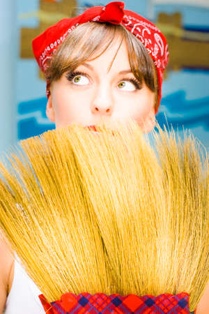 retro housewife: Retro Housewife Woman Looks To The Home Ceiling Cobwebs While Holding A Vintage Sweeping Broom In Classic House Wife Portrait Stock Photo