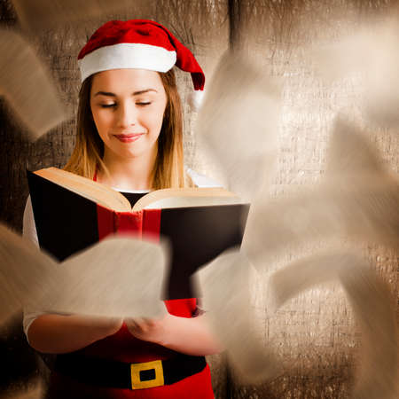Creative photo of a christmas girl reading open story book with twists and turns from falling pages. Xmas fairy tale