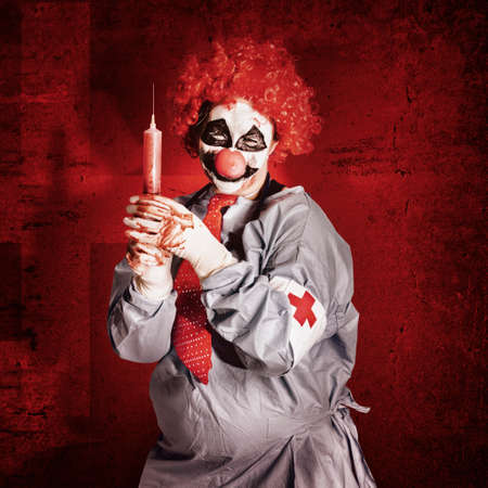 Dr Death clown administering ill vaccination injection with big red hypodermic needle. Vial sickness
