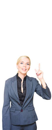 Marketing Professional Business Lady Pointing To The Sky While Promoting A Blank Copyspace Advertisement Display In A Isolated Studio Portrait On White Stock Photo