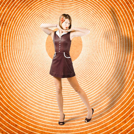 retro illustration: Combined photo illustration of a beautiful retro woman dressed as a pinup girl posing inside sixties time warp tunnel. Flashback tattoo design