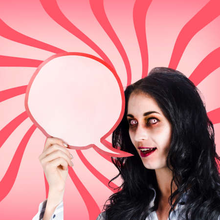 reanimated: Psychodelic female zombie shouting out a halloween announcement through a blood red speech bubble