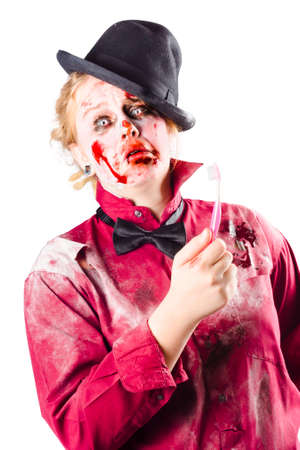 bewildered: A rotten zombie woman with a bewildered look and a toothbrush Stock Photo