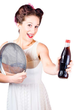 saleslady: Funny portrait of a retro pin-up girl handing over a bottle of soft drink in a depiction of food and beverage customer service Stock Photo