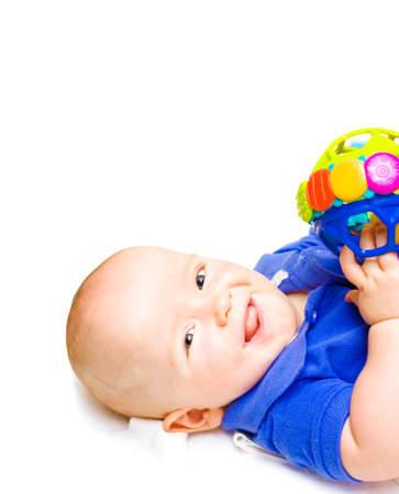 contented: Gurgling Happy Baby With Toy, baby lying on his back witha contented happy expression while playing with a colourful toy, studio close-up on white