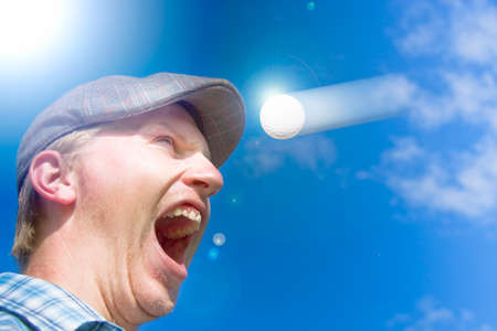 motioning: Sports Action Shot Of A Screaming Golfer Yelling Out In Horror At A Motioning Golf Ball Flying Directly At His Head In A Humor Sporting Conceptual Stock Photo
