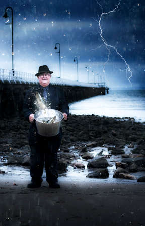 risking: Elderly Fisherman Holding A Bucket Of Fish During A Thunder Storm At A Pier Location In A Fishing And Recreation Activity