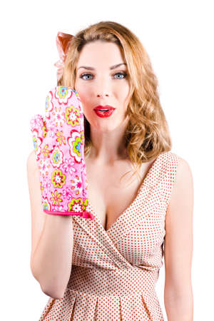 Retro pinup girl covering mouth with heat resistant mitt. Cookery secrets and handy tips