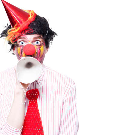 birthday clown: Humorous Birthday Clown Making Invitation To Guests Through Party Hat Over White Background
