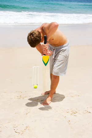 batters: A Class 'A' Bowl Sees A Ball Pass Through A Batters Block In A Game Of Beach Cricket