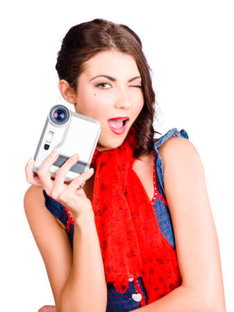 home video camera: Isolated portrait of a beautiful woman holding a home video camera, isolated over white