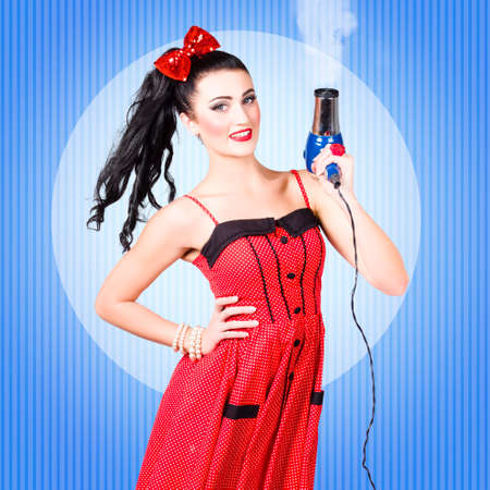 blow dry: Cute 50s cartoon pinup girl shooting with hairdryer when getting a smoking hot blow dry and style. Beauty salon hair styling concept Stock Photo