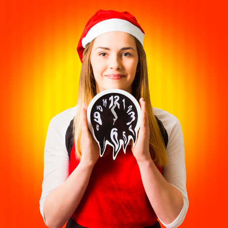 End of year christmas girl holding melting clock set to a 12 midnight time slot. Late for rush hour Stock Photo