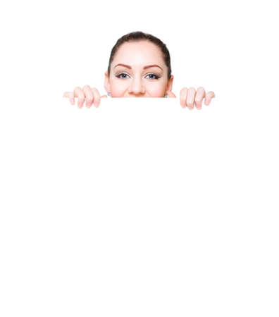 tradeshow: Cute Woman Peering Over White Tradeshow Banner While Displaying Blank Text Copyspace In An Advertising And Media Showcase, On White Background