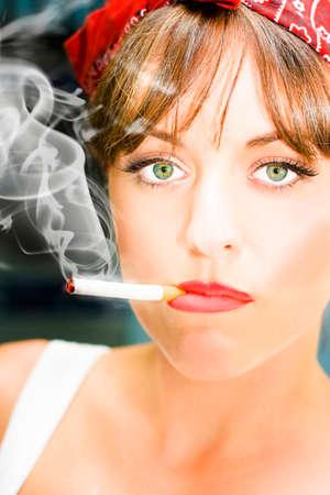 smolder: Smoke And Toxic Fumes Smolder From The End Of A Cigarette Butt Sitting In The Mouth Of A Unhappy Woman Smoker Staring With A Miserable And Sad Expression