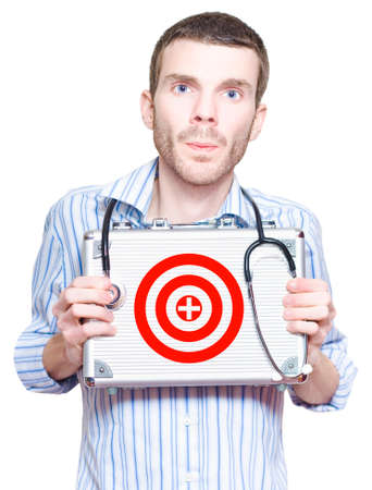 medical cure: Doctor With Target Symbol On First Aid Kit In A Medical Donation Concept Of Targeting A Cure