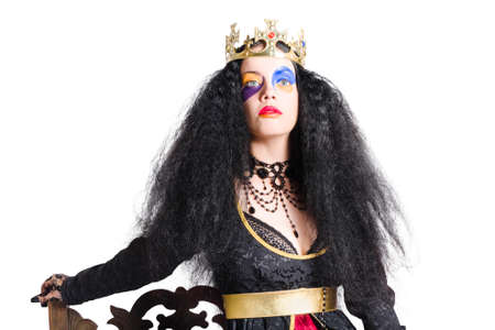 snob: Woman with long black hair, posing as a queen with a crown and black dress