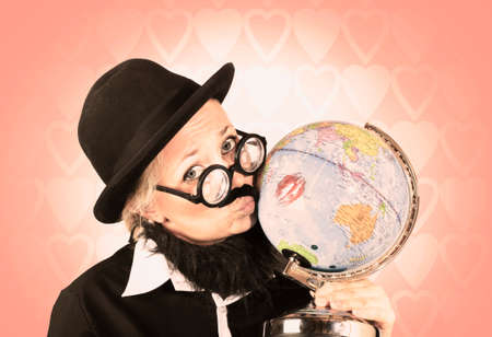 africa kiss: Conceptual shot of a comical nerdy person kissing the globe to show world conservation Stock Photo