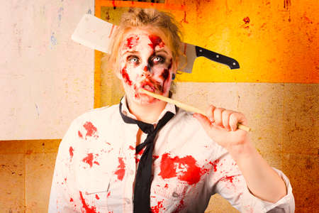 bad hygiene: Evil zombie chef thinking up unhealthy food idea in a depiction of halloween cooking