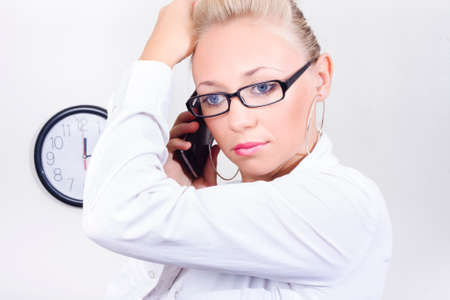 time pressure: Fresh and modern portrait of an office business woman talking on a smart mobile phone in a tight time pressure concept