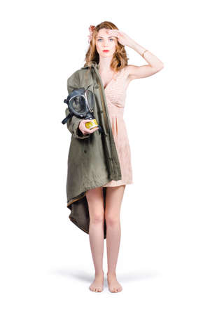 gasmask: Attractive young Australian army pinup woman saluting with Military gasmask and RAF jacket. ANZAC honour and pride