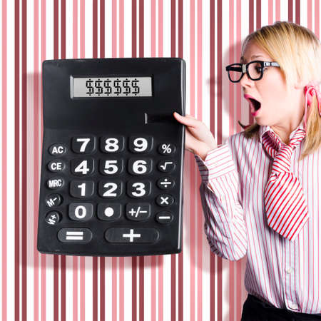 readout: Cute female account clerk holding massive calculator with dollar sign symbols on screen. Big return on investment concept Stock Photo