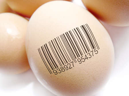 represent: Group Of Eggs Barcoded To Represent Product Identification Stock Photo