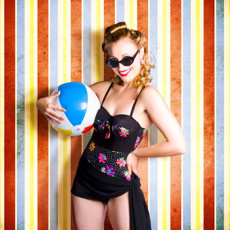 bathing costume: Vintage Woman Holding Colourful Beach Ball On Retro Background