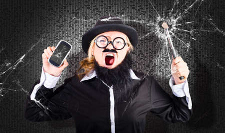 rampage: Cray cray businessman shouting out while smashing the front shop window of a mobile phone retailer when getting a crack in his smartphone screen Stock Photo
