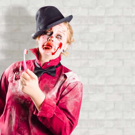 possessed: Funny possessed girl holding bloody toothbrush in bathroom. Gum disease
