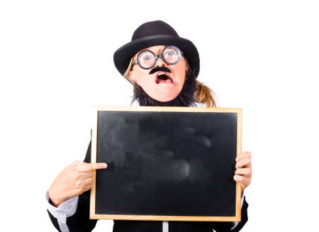 bewildered: Odd female teacher with a bewildered look holding a blank blackboard and pointing at it. Crazy about learning