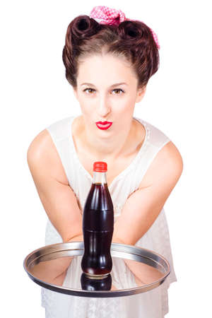 soda: Beautiful brunette pin up woman with 1950s hairstyle and classic red lips handing over drinks tray on white background. Good old fashioned hospitality