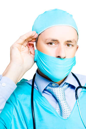 decibels: Concerned Doctor Listening To Patient Concerns With Hand To Ear In A We Hear You, Health Care Concept Isolated On White Background Stock Photo