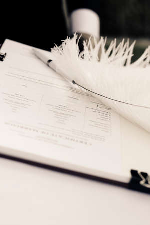 booklet: Signed Marriage Register Booklet And Quill In A Just Married Concept
