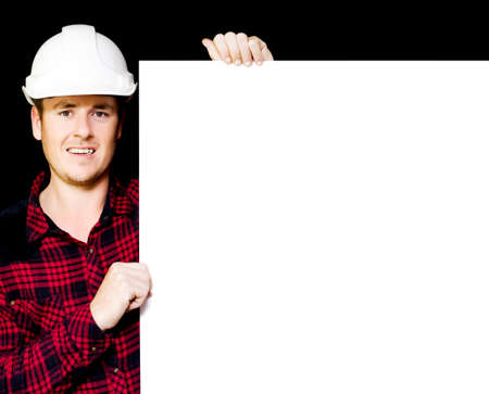 overseeing: Construction supervisor displaying a blank white blueprint as he holds a meeting to discuss the building project and strategy Stock Photo