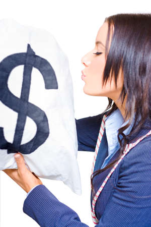 covetous: Closeup On A Young Attractive Female Business Person Kissing Dollar Sign Money Bags While Being In Love With Money In A Wealth And Finance Concept On White