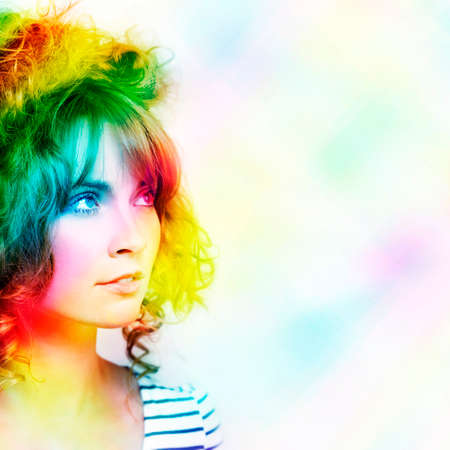 bright colors: Colorful Abstract Design Of A Beautiful Young Woman With Colourful Wavy Hairstyle Standing In A Vibrant Rainbow Of Magic Colours With Space For Your Text Stock Photo