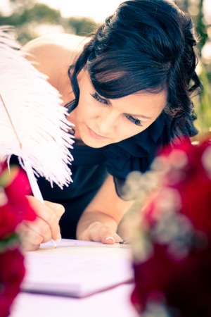 matron: Brides Best Woman The Maid Of Honour Signs The Wedding Registar As A Witness At A Marrige Ceremony