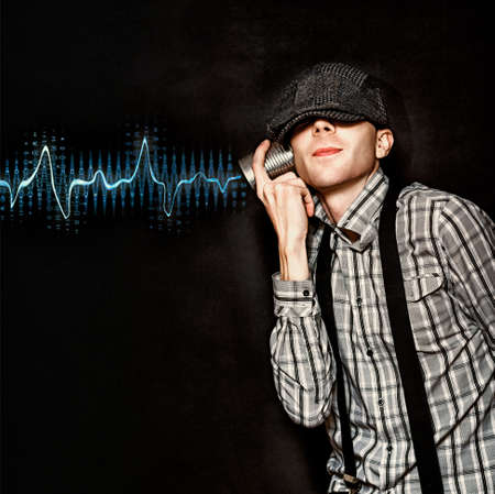 ear phones: Cute Little Vintage Boy Playing With Tin Can Phone While Listening To Frequency Vibration Waves Being Relayed From A Communication Transmission Signal