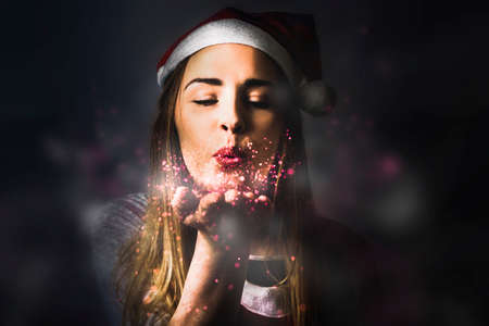 december: Fantasy style photo of a pretty blonde female elf making dreams come true when sharing the magic of christmas