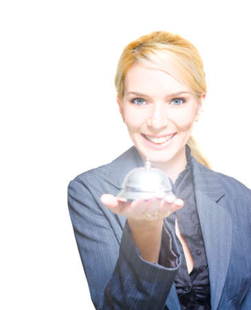 over the counter: Smiling Happy Blond Business Woman Holds A Retro And Vintage Service Bell In A Classic Shopping Commerce Concept Of Old Fashion Service Titled Help At Hand