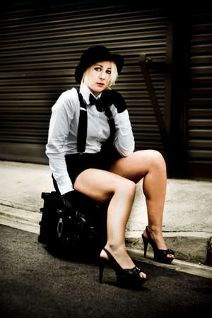stardom: Woman Sits On A Travel Suitcase While Waiting For Her Ride To Fortune And Fame On The Road To Stardom