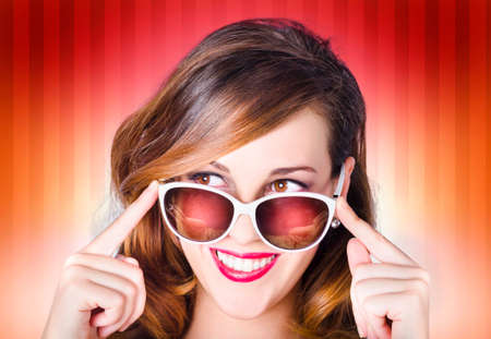 over white: Face of a good-looking retro pinup girl wearing trendy sunglasses with hip fashion style