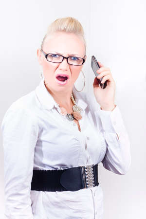 rage: Stressed employee expressing mobile phone rage when communicating with frustrating clients in workplace
