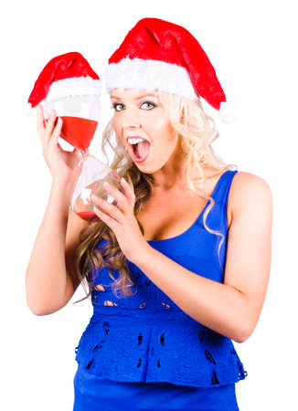 carols: Isolated Blond Woman With Surprised Expression Holding Hourglass With Running Red Sand In A Just Minutes To Christmas Time Conceptual On White Background