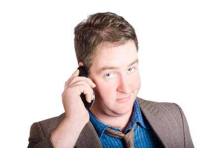 befuddled: Face of a male business person looking uncertain while on a corporate cell phone. Call of confusion