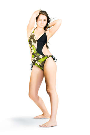 one piece: Full Body Studio Image Of A Young Attractive Woman Posing In A Modern One Piece Swimsuit, Isolated On White Background