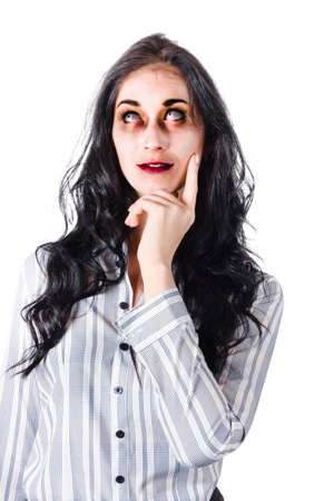 one hand: Half body portrait of dead or zombie businesswoman looking upwards thoughtfully, white background Stock Photo