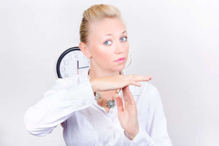 time out: Stern Looking Business Person Gesturing Time Out With Hand Signal In Workplace